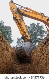 Excavator digging a deep trench