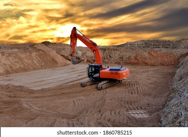 Excavator digging the pit foundation on sunset background. Earthwork in excavation and backfilling of soil is required for construction of trenche. Construction machinery for earthmoving