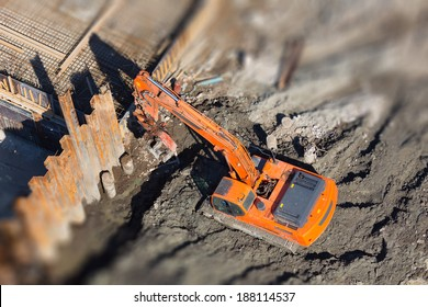 Excavator digs a hole for home designs