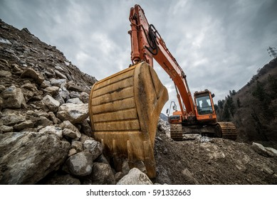 .excavator for earth moving at construction site, project in progress