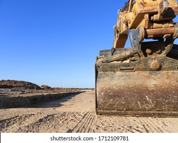 Excavator Earth Moving on a New Property Estate with a clear Blue Sky Backgound
