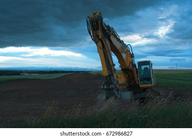 Excavator in the evening on the construction site