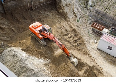excavator. heavy machine construction site top view