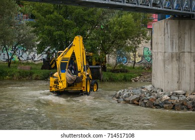 Excavator helping with rescue works after a hurricane caused flooding in a city.