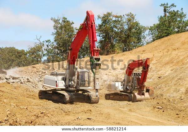 Excavator Hydraulic Rock Breaker Taking Down Stock Photo