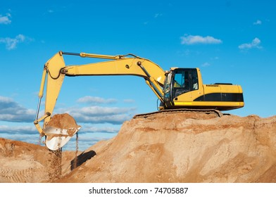 excavator loader during earthmoving works outdoors at construction site