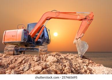 Excavator loader machine with sunset background