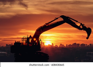 Excavator loader model with Silhouette on sunset at city building background,Concept 