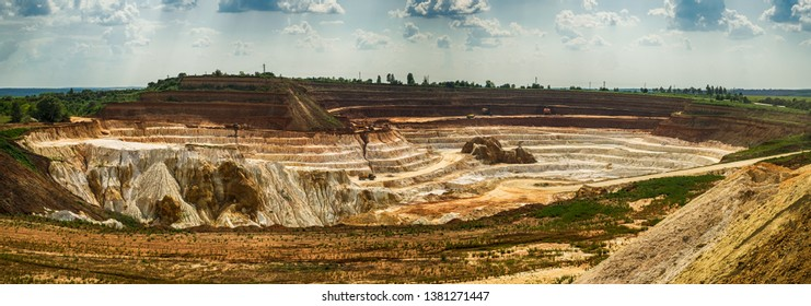 Excavator loading dump truck with raw kaolin in kaolin open pit, Vetovo city, Bulgaria
