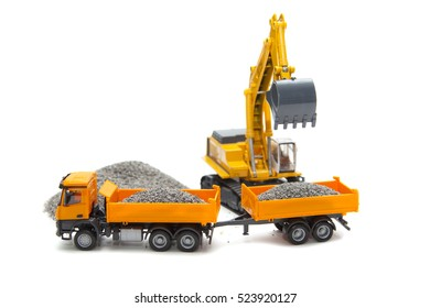 excavator is loading of heavy dump-body track on white background