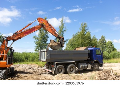 The excavator loads the tipper truck on construction site