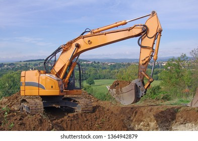 Excavator machine in action during earth moving works