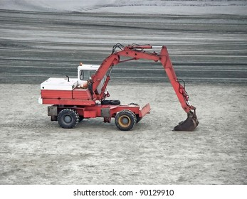 excavator machine parked on the sand