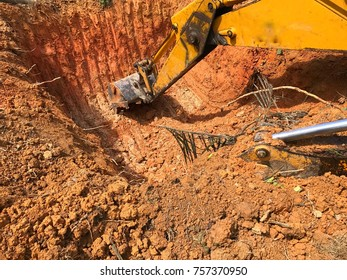 Excavator make hole drain in farm to avoid animal