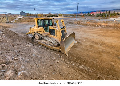 Excavator making earth movements in the works of expansion of the ring road of Segovia, in Spain