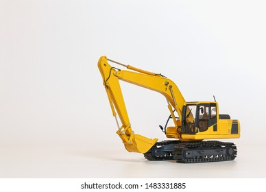 Excavator model on a white background with copy space