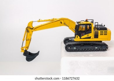 Excavator    model  with a technology  machinery  isolated on white background