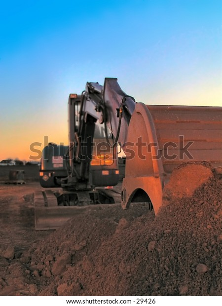 Excavator in morning light
