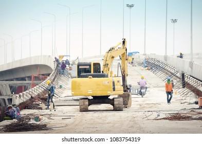 excavator move on bridge