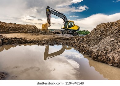 Excavator with mud in a construction site, hard working conditions