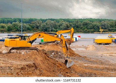 Excavator on a building site in rainy weather