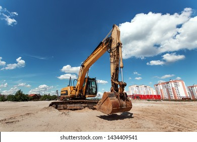Excavator on a construction site against a blue sky. Construction, technology, architecture.