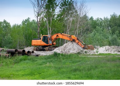 Excavator on the construction site building the pipeline