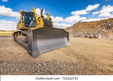 Excavator on a construction site of a road
