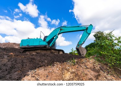 Excavator on construction site under blue sky