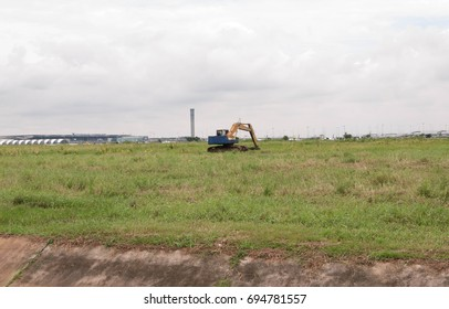An excavator on the field.