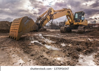Excavator on a hard day of work on a construction site