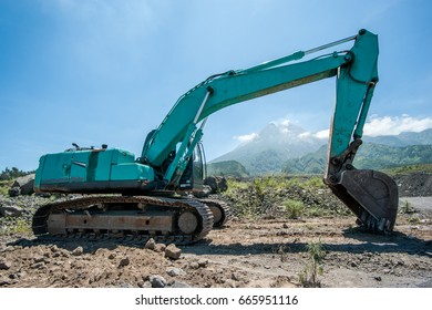 Excavator on new construction site, in the background the blue sky