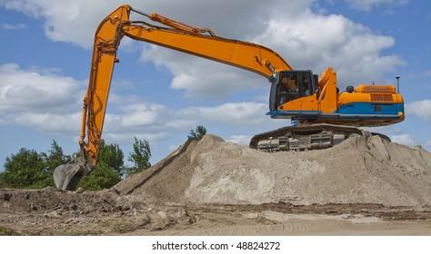 Excavator on sand