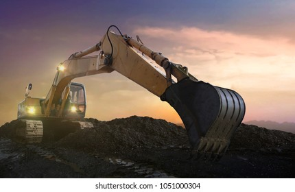 excavator on site at sunset