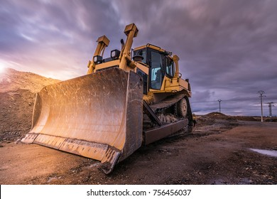 Excavator performing earthmoving work on construction sites of a road