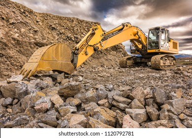 Excavator performing stone extraction work in an open pit stone mine