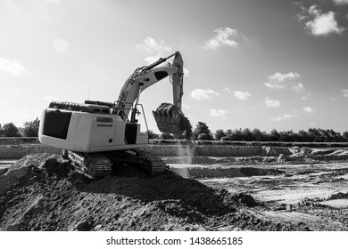 excavator picking up dirt on construction site