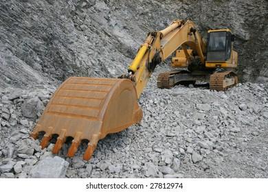 Excavator in the quarry