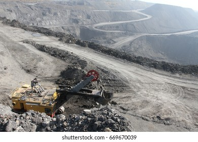The excavator in the quarry. The view from the top. Mining. Coal mining