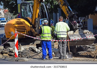 Excavator at the road construction in the city