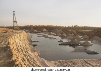 A dragline excavator in a sand quarry. Phosphorite Mine. Bulk material handling