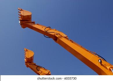 Excavator scoop in sky