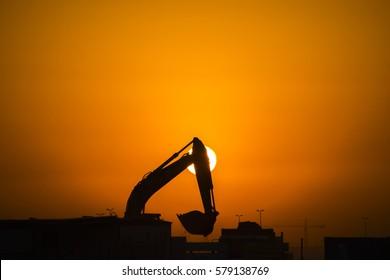 excavator in silhouette