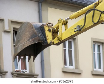 the excavator and the slippers