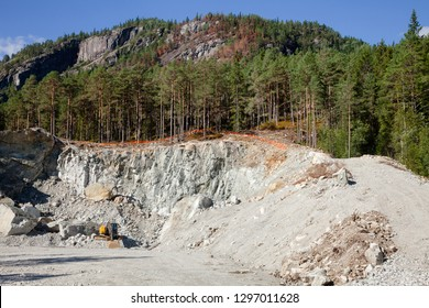 Excavator at small quarry in Norway, Scandinavia, mining construction aggregate and riprap
