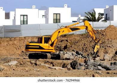 Excavator standing in sandpit