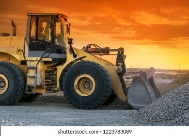 Excavator in a stone mine transporting and stacking gravel