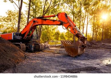 excavator and sun light