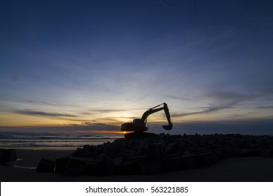 An Excavator and a Sunset