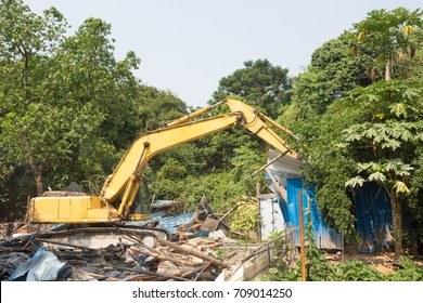 excavator are tearing down the neo-treasure hill building